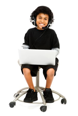 Happy boy using a laptop isolated over white Stock Photo