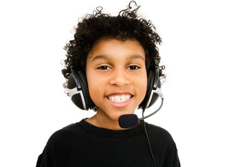 Boy wearing a headset and smiling isolated over white photo