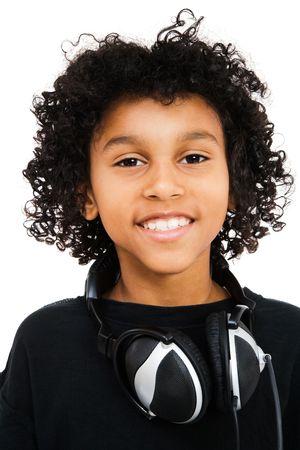 Latin American boy with headphones around his neck isolated over white