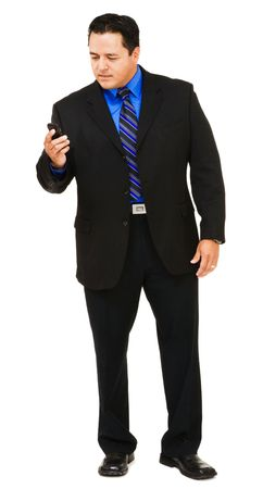Businessman on the mobile phone isolated over white Foto de archivo