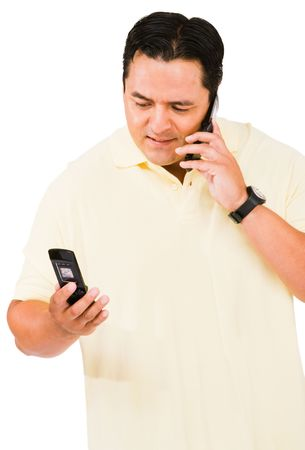 telecommunicating: Mid adult man using a mobile phone isolated over white