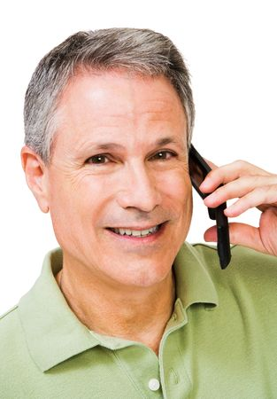 phoning: Smiling man talking on a mobile phone isolated over white Stock Photo