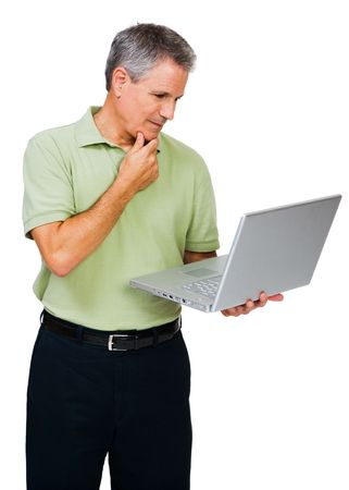 telecommunicating: Thinking man using a laptop isolated over white