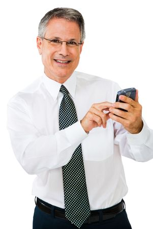Businessman using a pda and smiling isolated over white Stock Photo - 4941138