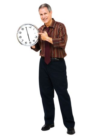 Portrait of a businessman showing a clock isolated over white photo