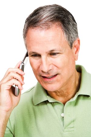 telecommunicating: Man using a mobile phone isolated over white