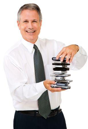 Portrait of a businessman holding a stack of phones isolated over white photo