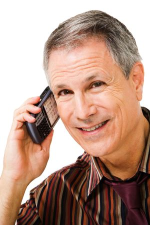 telecommunicating: Smiling businessman talking on a mobile phone isolated over white Stock Photo