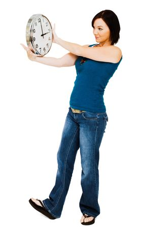 blissfulness: Young woman holding a clock isolated over white