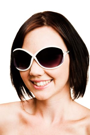 blissfulness: Close-up of a woman wearing sunglasses isolated over white