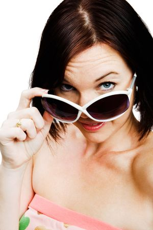blissfulness: Portrait of a woman wearing sunglasses isolated over white Stock Photo
