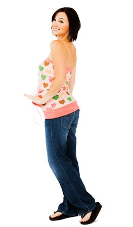 blissfulness: Smiling woman standing and posing isolated over white
