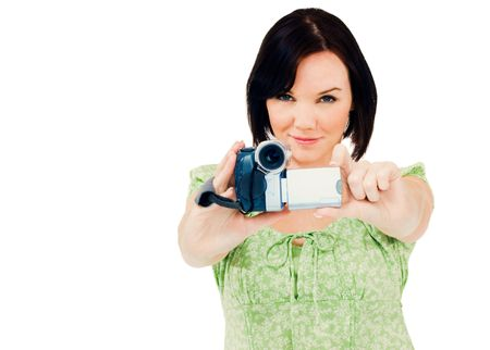 Happy woman holding a home video camera isolated over white