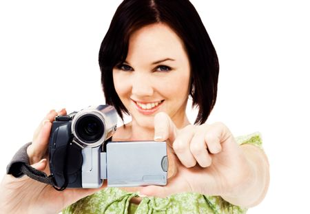 Portrait of a woman holding a home video camera isolated over white Stock Photo