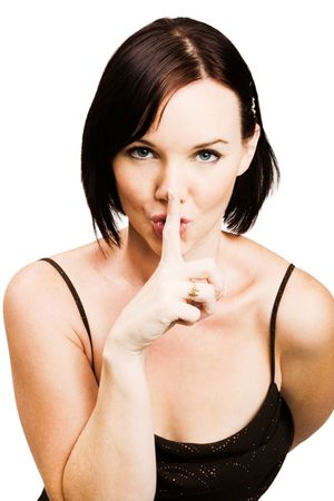 Woman with finger on lips isolated over white Stock Photo - 5235397