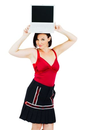 Young woman holding a laptop isolated over white photo