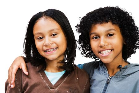 Portrait of a boy and girl smiling isolated over white