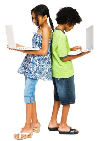 Boy and girl working on laptops isolated over white photo