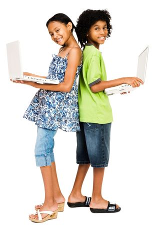 Young boy and girl holding laptops and smiling isolated over white photo