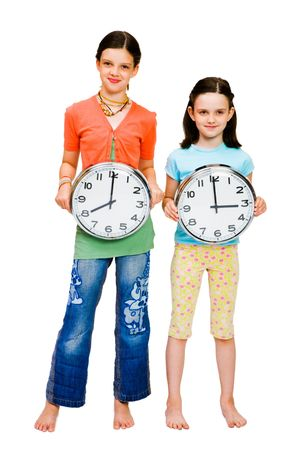 Portrait of girls holding clocks isolated over white photo