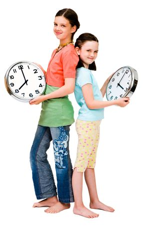 Cute girls holding clocks isolated over white photo