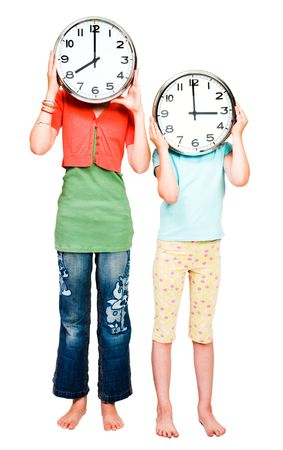 Caucasian girls holding clocks isolated over white Stock Photo