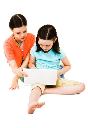 Girls using a laptop isolated over white