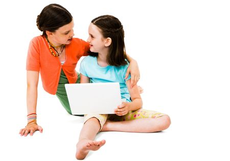 Smiling girls using a laptop isolated over white Stock Photo - 5256972
