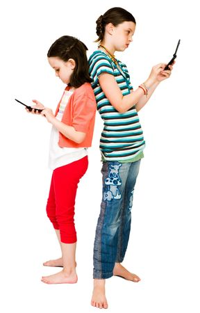 Girls text messaging on mobile phones isolated over white photo