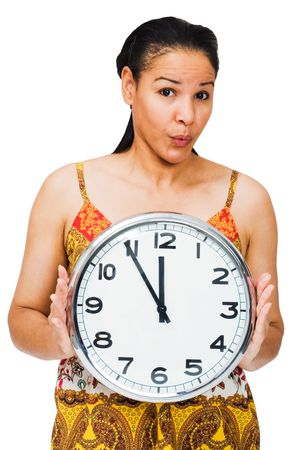 puckering: Woman holding a clock and puckering isolated over white