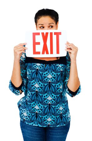 Fashion model holding exit sign isolated over white Stock Photo