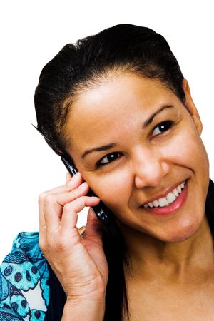 telecommunicating: Woman talking on a mobile phone and smiling isolated over white