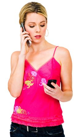telecommunicating: Woman using mobile phones isolated over white Stock Photo