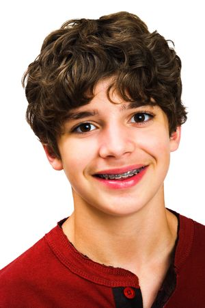 tween boy: Chid posing and smiling isolated over white