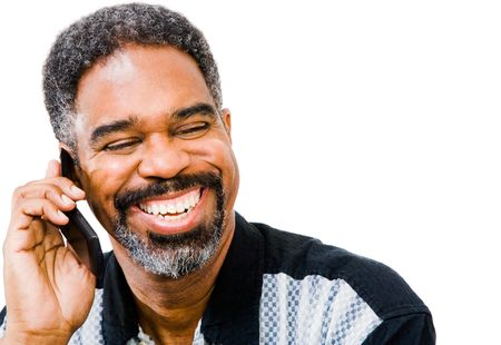 telecommunicating: African American man talking on a mobile phone isolated over white Stock Photo