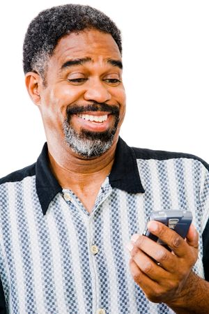 Smiling man text messaging on a mobile phone isolated over white