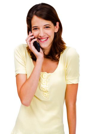 telecommunicating: Confident woman talking on a mobile phone isolated over white