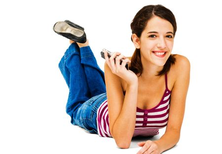 telecommunicating: Woman holding a mobile phone and smiling isolated over white