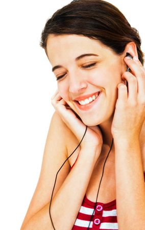 Close-up of a woman listening to music on earbud isolated over white