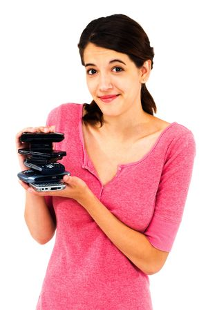 telecommunicating: Woman holding a stack of mobile phones isolated over white