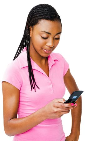 Teenager text messaging on a mobile phone and smiling isolated over white photo