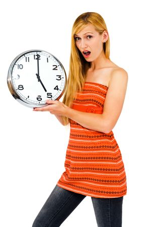 Shocked young woman holding a clock isolated over white photo