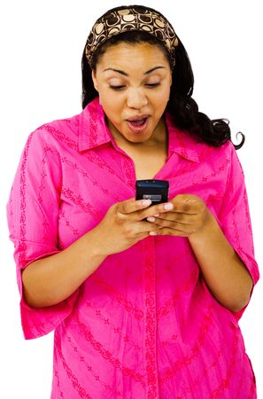 telecommunicating: Young woman text messaging on a mobile phone isolated over white Stock Photo