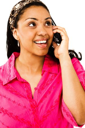 telecommunicating: Beautiful woman talking on a mobile phone isolated over white