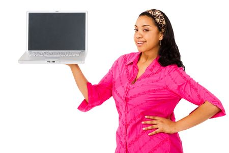 telecommunicating: Young woman showing a laptop and smiling isolated over white