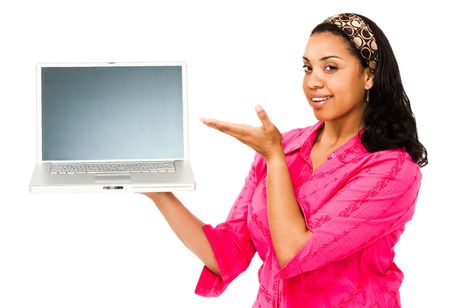 Smiling young woman showing a laptop isolated over white