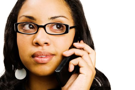 telecommunicating: Young woman talking on a mobile phone isolated over white Stock Photo