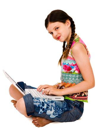 Portrait of a girl using a laptop and smiling isolated over white Stock Photo