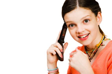 Confident girl talking on a mobile phone isolated over white Stock Photo - 5635743