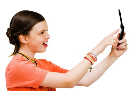 Smiling girl text messaging on a mobile phone isolated over white photo